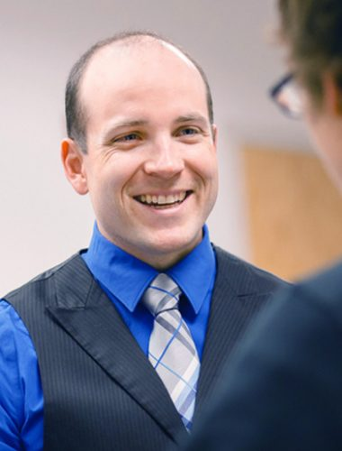 Chris Stone, PA-C, orthopaedics, talks to patient